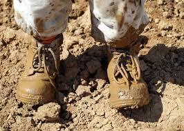 SHOES COVERED WITH MUD